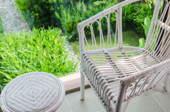 Rattan chair with garden view Royalty Free Stock Images
