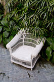 Rattan chair with green trees at outdoor Stock Photos