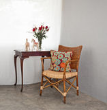 Rattan chair in a patio setting Stock Photos