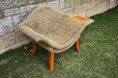Rattan chair with side table Stock Photos
