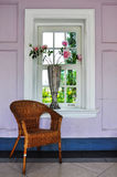 Rattan chair. With vase and window Stock Image