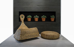 Rattan chair in wood tile back groung and 5 flowerpod. Rattan chair in wood tile back groung and flowerpod Royalty Free Stock Photo