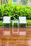Rattan chairs and table in empty garden stock photo