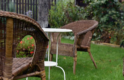 Rattan chairs and white table Royalty Free Stock Image