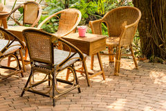 Rattan chairs and wood table Stock Images