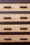 Rattan drawers in drawer cabinet Stock Photo
