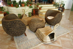 Rattan furniture. Rattan chairs and table in a hotel lobby Stock Photo