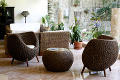 Rattan furniture. Rattan chairs and table in a hotel lobby Royalty Free Stock Image