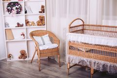 Rattan furniture in the children`s bedroom with toys and New Year elements. In gentle colors Royalty Free Stock Images