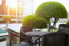 Rattan  furniture. Close up of outdoor rattan garden furniture on terrace Stock Image
