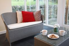 Rattan furniture in conservatory Royalty Free Stock Image