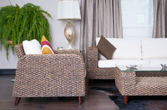 Rattan Furniture. Rattan couch and armchair set royalty free stock photos