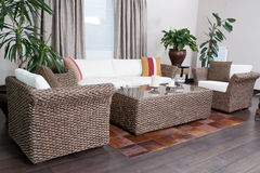 Rattan Furniture. Rattan couch and armchair set Royalty Free Stock Images
