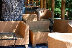 Rattan furniture in the sun. Rattan chairs and sofas on a porch Stock Images