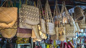 Rattan handbag in front of souvenir shop in Samarinda, Indonesia. Rattan handbag with tribal pattern hanging  in front of souvenir shop in Samarinda, Indonesia Stock Image