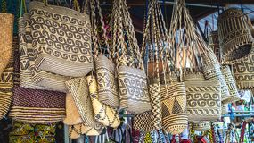 Rattan handbag in front of souvenir shop in Samarinda, Indonesia. Rattan handbag with tribal pattern hanging in front of souvenir shop in Samarinda, Indonesia Royalty Free Stock Photo