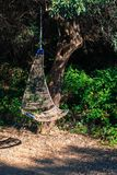 Rattan Hanging chair. Rattan outdoor cradle chair in the garden royalty free stock photo