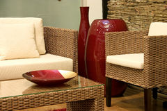 Rattan living room. Close up of living room with sofas from rattan and arm chair royalty free stock image