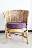 Rattan and palm chair Royalty Free Stock Image