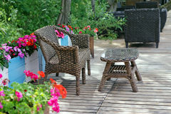 Rattan patio chair and table Royalty Free Stock Photos