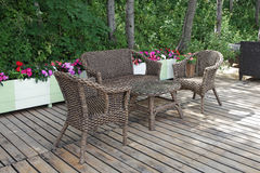 Rattan patio chairs and table Royalty Free Stock Photo