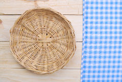 Rattan plate or basket on wooden table Royalty Free Stock Image