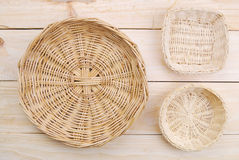 Rattan plate or basket on wooden table Stock Image