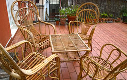 Rattan seats table and chairs outside on balcony Royalty Free Stock Images