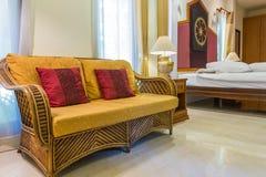 Rattan sofa in bedroom Royalty Free Stock Image