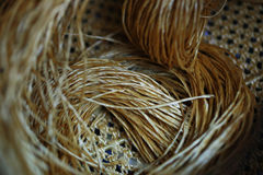 Rattan strips for make baskets, woven from willow twigs. typically made from interwoven strips of cane or wire. Baskets woven from willow twigs. typically made Stock Photos