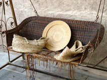 Rattan Swing Sofa. An Empty Brown Rattan Swing Chair Stock Photography