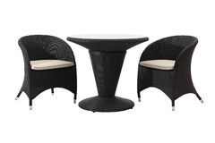 Rattan table and chairs. Contemporary black rattan design of table set with two chairs Stock Images