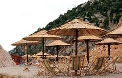 Rattan Umbrellas and Lounges Royalty Free Stock Images