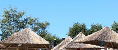 Rattan Umbrellas. On a Mamaia Romania sand beach Stock Image