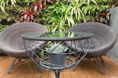 rattan wicker chair and desk on patio Stock Photo