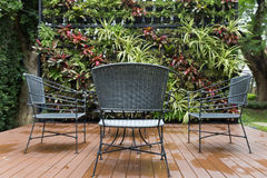 rattan wicker chair and desk on patio Royalty Free Stock Photos