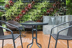 rattan wicker chair and desk on patio Stock Photos