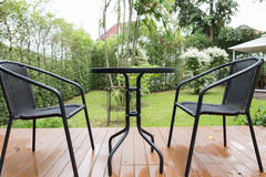 rattan wicker chair and desk on patio Royalty Free Stock Photography