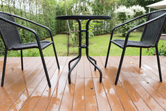 rattan wicker chair and desk on patio Stock Photography