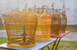 Rattan wood bird cages on the tables Stock Photos