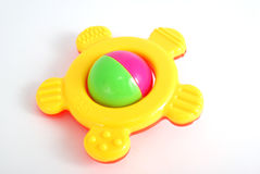 Rattle. Children's rattle from plastic on a white background Royalty Free Stock Photography