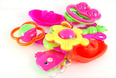 Rattle. Children's rattle from plastic on a white background Royalty Free Stock Photo