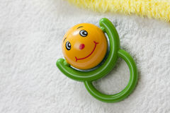 Rattle with smile Royalty Free Stock Images