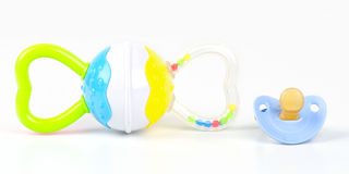Rattle toy and pacifier. Isolated on white background Royalty Free Stock Images