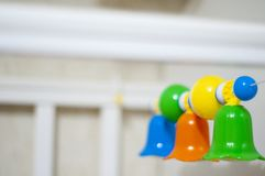 Rattles above baby cot stock photography
