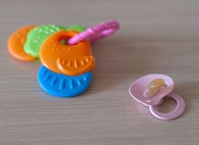 Rattles and pacifier Stock Images