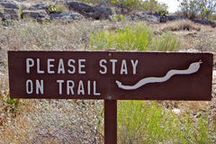 Rattlesnake Warning Sign. A sign warning hikers of rattlesnakes off the trail Stock Photography