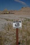 Rattlesnakes warning sign. This rattlesnakes warning sign alerts tourists to potential dangers of snakes lurking beneath rocks in Badlands National Park, South Royalty Free Stock Images