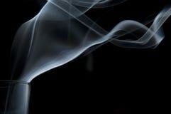 Rauch, der aus ein Glas herauskommt Stockfotografie
