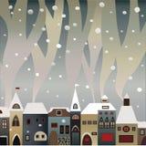 Rauchende snow-covered Häuser Stockfotografie